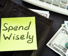 Open wallet with memo spend wisely. Money habits.