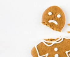 gingerbread cookie man with a frowny face and head snapped off