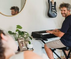 man playing keyboard for woman